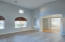 den/office/bonus room with soaring ceilings