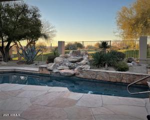 Pool with water feature, golf course view, large patio