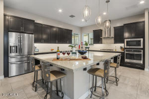 This open concept floorplan boasts an upgraded kitchen with oversized center island that flows effortlessly into the dining and great room