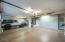 Epoxy floors, built-in cabinets and new insulated garage doors.