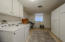 HUGE INSIDE LAUNDRY ROOM WITH CABINETS AND A WINDOW