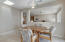 Breakfast nook opens to living space and kitchen