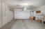 A full wall of storage cabinets in the garage.