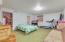 Basement features bonus room, bedroom, and storage room.