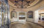 Elegant circular foyer already revealing some of the many special features in this home
