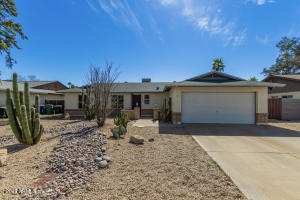 North Facing Home with plenty of Driveway Space and RV Gate on West side of home!