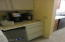Wine and coffee bar with wine cooler below