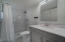 Master bathroom is bright and open with a new TILE Shower and features cabinets for under counter space.