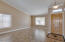 Vaulted ceiling and gorgeous tile flooring greet you