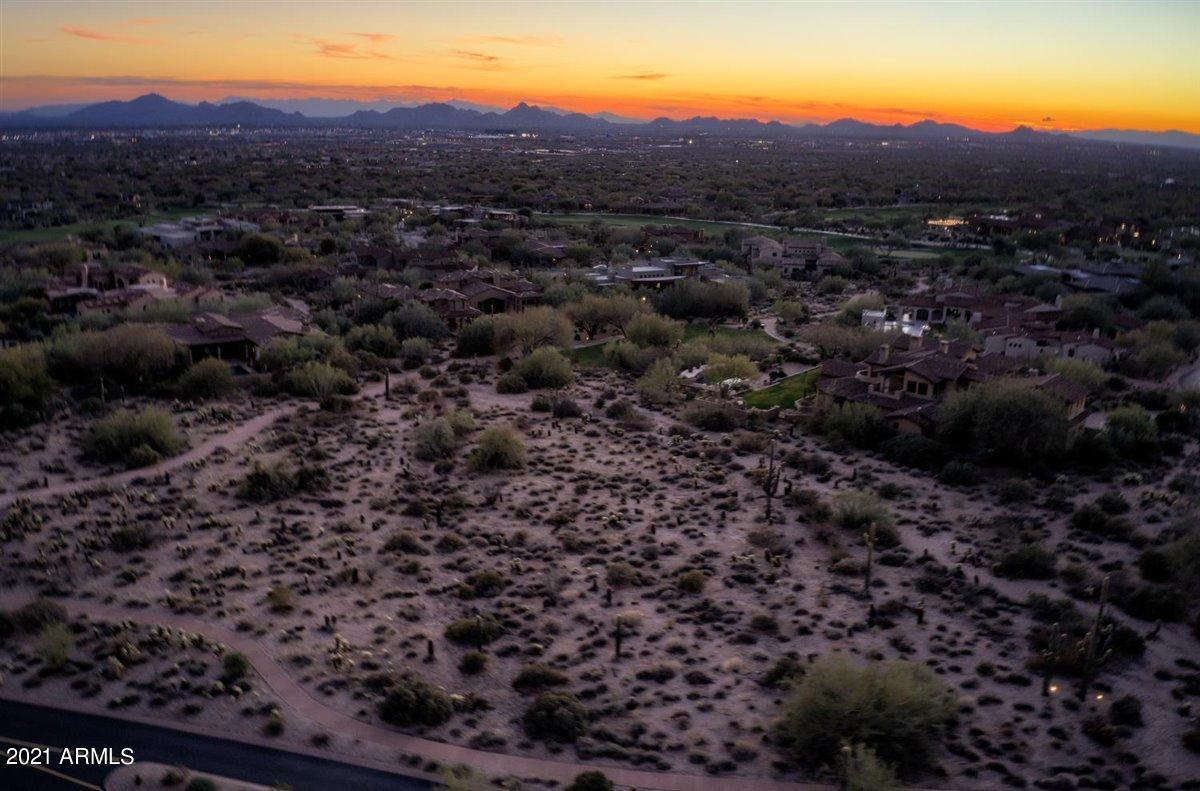 Exciting opportunity to build your luxury retreat in the guard gated DC Ranch Country Club community!  This 1.19 acre flag lot offers a 27,000 square foot building envelope, spectacular mountain and city light views, and a desirable south-facing exposure.  This homesite is only a minute's walk to the Country Club at DC Ranch clubhouse and offers easy access to the neighborhood's well-maintained walking paths.