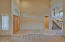 Double door entry, arched hall ways, coat closet, niches for art work, custom lighting