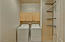 Laundry room with upper cabinet and storage shelves, Washer Dryer may convey, in AS IS condition