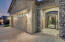 Pavered driveway and travertine courtyard entrance