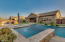 Oversized spa with negative edge into the pool