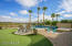 Large backyard which includes putting green, separate spa and pool overlooking the 14th green. Mountains, water and golf course views.