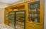 2-100 bottle plus, 3 temperature wine coolers, custom built cabinetry glass storage & drawers