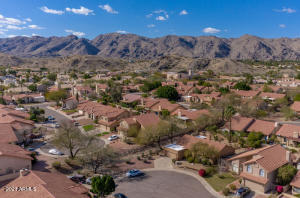 Aerial view showing the south side of South Mountain City park in the back.