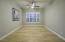 Bonus room perfect as den/office or formal dining room.