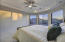Master bedroom offers wonderful mountain views and direct access to patio area.