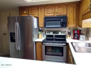 Newer appliances are already installed for you with well made oak cabinets