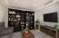 Double Doors reveal large Den, Library or Office adjacent Living Room (staged)