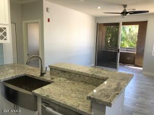 High quality remodel. Open concept kitchen w/nw self-closing cabinets & drwrs, all nw stainless Samsung applncs, granite countertops, touchless faucet, nw garbage disposal, nw tile flooring thruout, nw baseboards, smth textured walls & ceilings, USB outlets, raised hallwy ceiling, nw A/C lines, 3 stage shwr heads & lrg niche, frameless glass shwr, upgraded to dbl sinks on granite cntrtp, lit mirrors, nw solid wood interior drs, nw remote contrld ceiling fans, pwr shade in bedrm, walk-in closet, wood burning fireplace, tiled balcony, nw high efficiency 40gal watr htr w/leak detector, nw TV in bedrm w/swivel mnt, LED can lghts thruout, nw Google Nst Progrmbl thermostat & smoke detector & Ring drbell camera w/peephole. Updtd electrcl & plumbng. Quiet, great view, walkn distnc 2 shopng/dining.