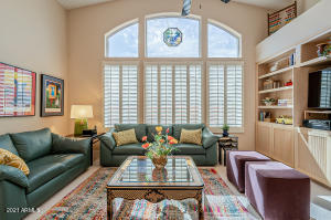 Cozy family room with plantation shutters & built-in shelves & cabinets