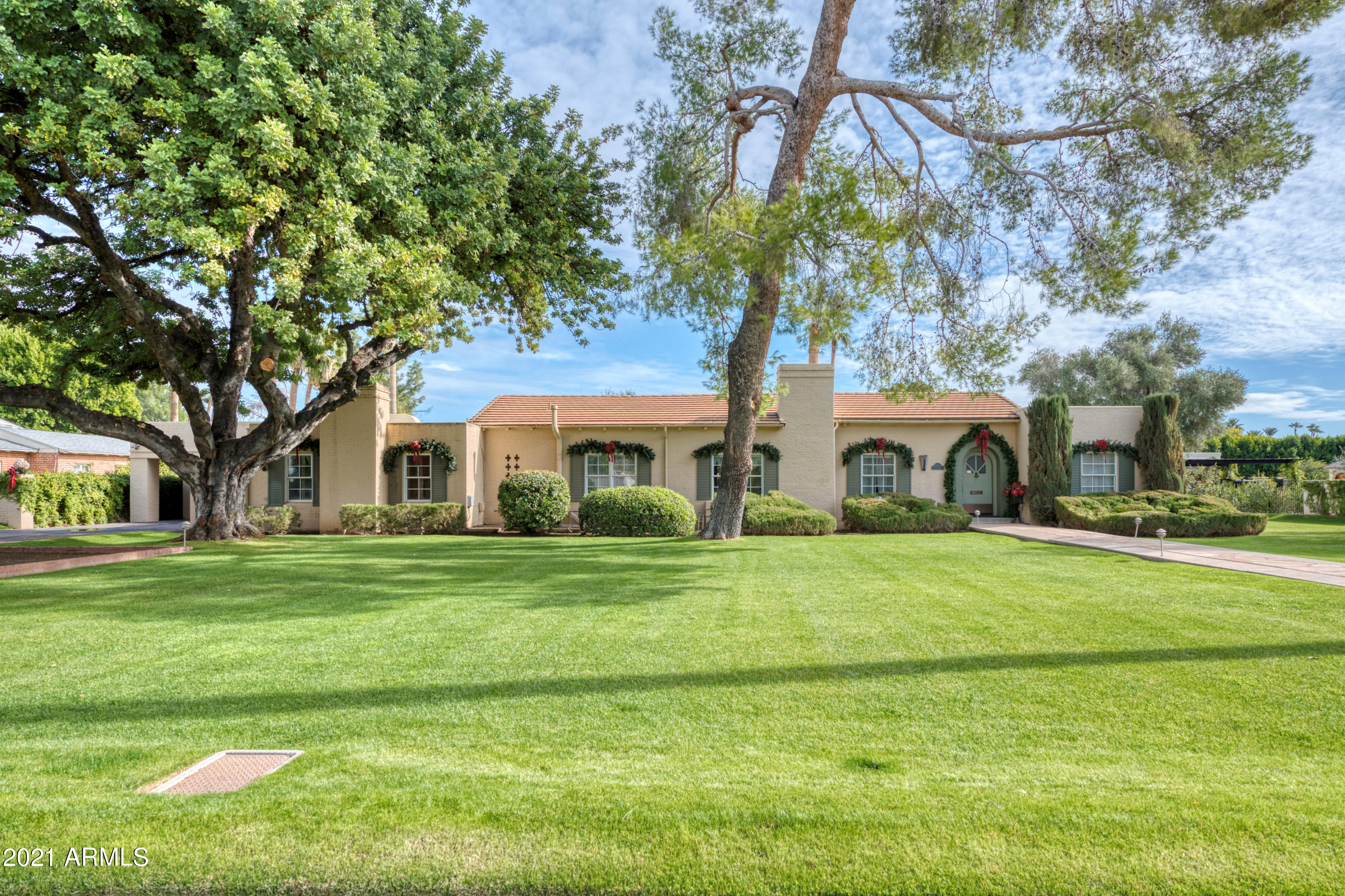 Beautiful and well-maintained home in the coveted and gated Phoenix Country Club community. 4 bedrooms + office, 3.5 bathrooms. This prime location cannot be beat.  The home was originally owned by the Goldwater family and has not been available to the market for over 35 years!