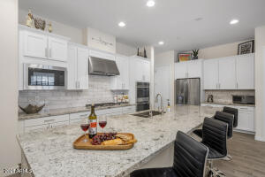 Kitchen includes double ovens, upgraded GE appliance package, gas cooktop and more.