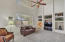 Roomy Family Room with Soaring Ceilings and Views to the Back Yard
