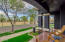 Front porch living across from huge field!