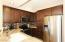 SLAB GRANITE & STAINLESS KITCHEN IS OPEN TO THE GREAT ROOM!