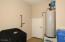 EXTRA STORAGE ROOM IN GARAGE AND PRE-PLUMBED FOR WATER SOFTENER!