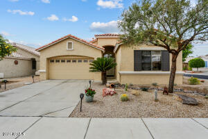 This lovely home, located in the 55+ guard-gated resort community of Arizona Traditions, is nestled on a N/S facing corner lot.