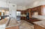 Granite Counter Tops in this custom large kitchen opens to family room