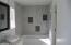 Dual sinks, shower, tub, separate door to toilet