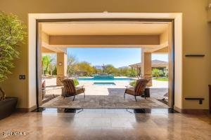 Access your stunning resort style backyard with a touch of a button to open your sliding glass doors.