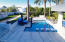 Baja shelf with umbrella for year round R&R in your heated pool.
