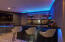 Beautiful bar with sink and cove lighting surrounds.