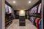 Marie Kondo pride! Stackable washer/dryer enclosed inside closet.