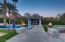Gas fire bowls lead to the pool pavilion and putting green.