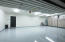 Newly epoxied garage floor in this well lit perfect 3 car garage.
