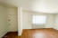 Bonus room features separate entrance. Could be an additional bedroom, home office or mother-in-law suite.