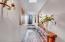 Hallway to powder room from kitchen
