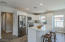 Open kitchen with new white shaker cabinets, pantry, quartz countertops and recessed ceiling lights