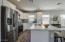 Island with sink, dishwasher and Breakfast Bar