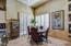 Dine in Kitchen Area w/Plantation shutters & doors leading to BBQ area