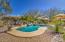 Tropical backyard w/heated salt water pool & water feature!