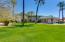 Lush greens surround this resort-like home