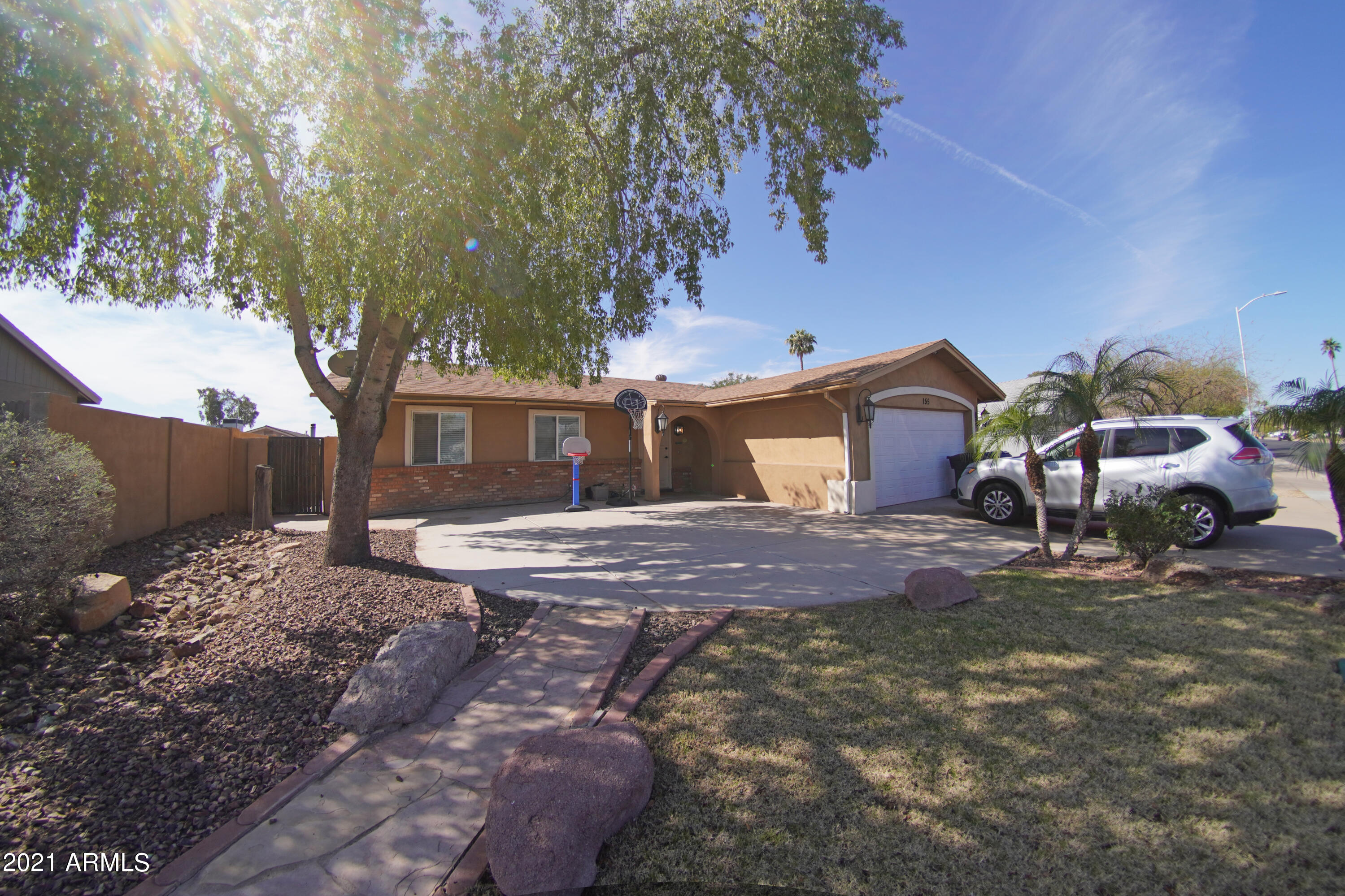 Back on the Market! Beautiful 3 bedroom, 2 bathroom home in the heart of Mesa, close to North Loop 202! This home features  an oversized living room, tile in high traffic areas and carpet in the living room and bedrooms. Through 2 French doors you head out to the backward and are greeted by grass, a built in fireplace and grill. RV gate on the side of the home  gives easy access to the backyard. NO HOA! The A/C unit is less than 1 year old